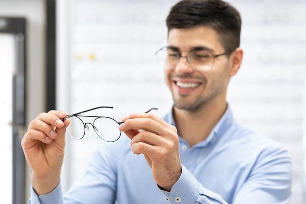 man choosing glasses