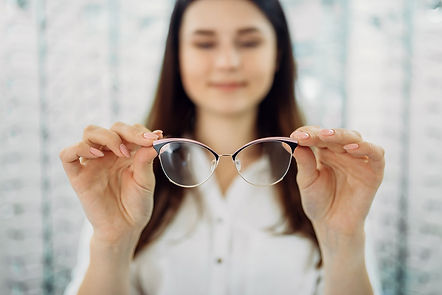 choosing glasses at Stella Griffiths Opt