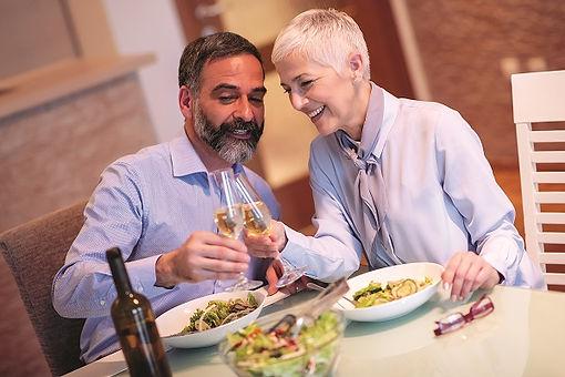 senior couple wearing hearing aids