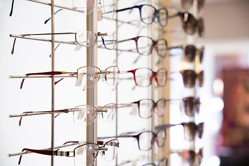 Glasses displayed on shelve in optical practice