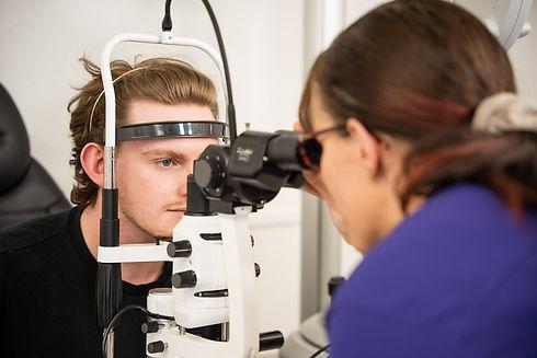 Young man having an eye examination test