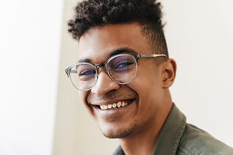 Young man smiling wearing his new glasses