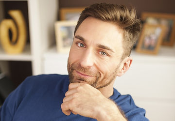 portrait-of-handsome-man-sitting-on-sofa