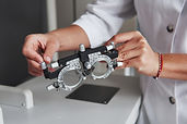 female-hands-holding-the-optical-device-