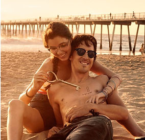 Couple spending time at the beach wearing Ray-Ban Glasses