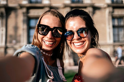 Firneds enjoying spending time together and wearing sunglasses