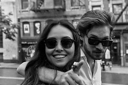 Couple wearing moscot glasses