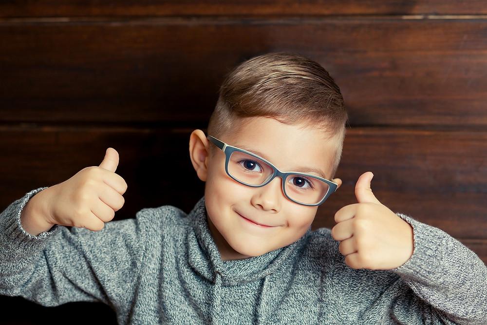 happy child wearing glasses