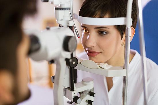 optometrist checking patient eyesight and eye health