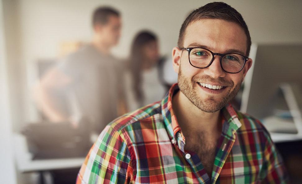 cheerful-entrepreneur-wearing-glasses-in