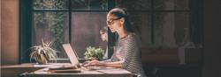 Lady Wearing Glasses using Laptop