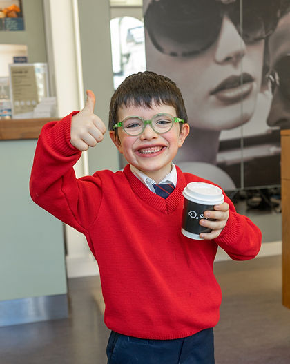 Child with glasses from eye world opticians