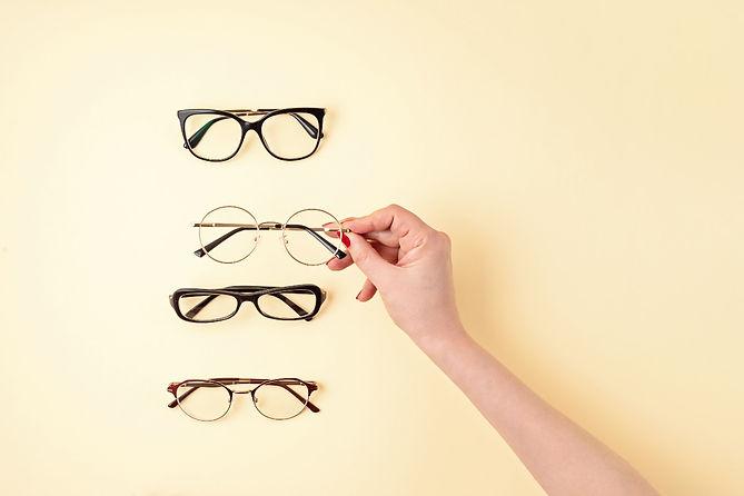 woman-hand-holding-eyeglasses-optical-st