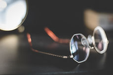 glasses on a bedside table
