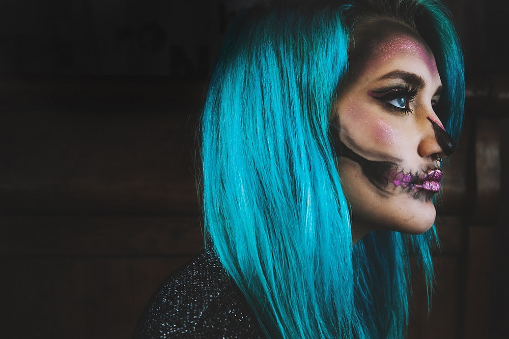 girl wearing halloween costume with blue contact lenses
