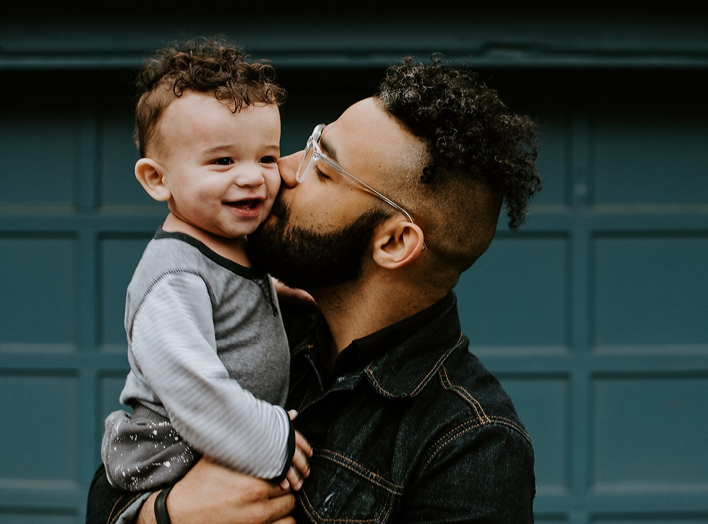 man giving loving look to child