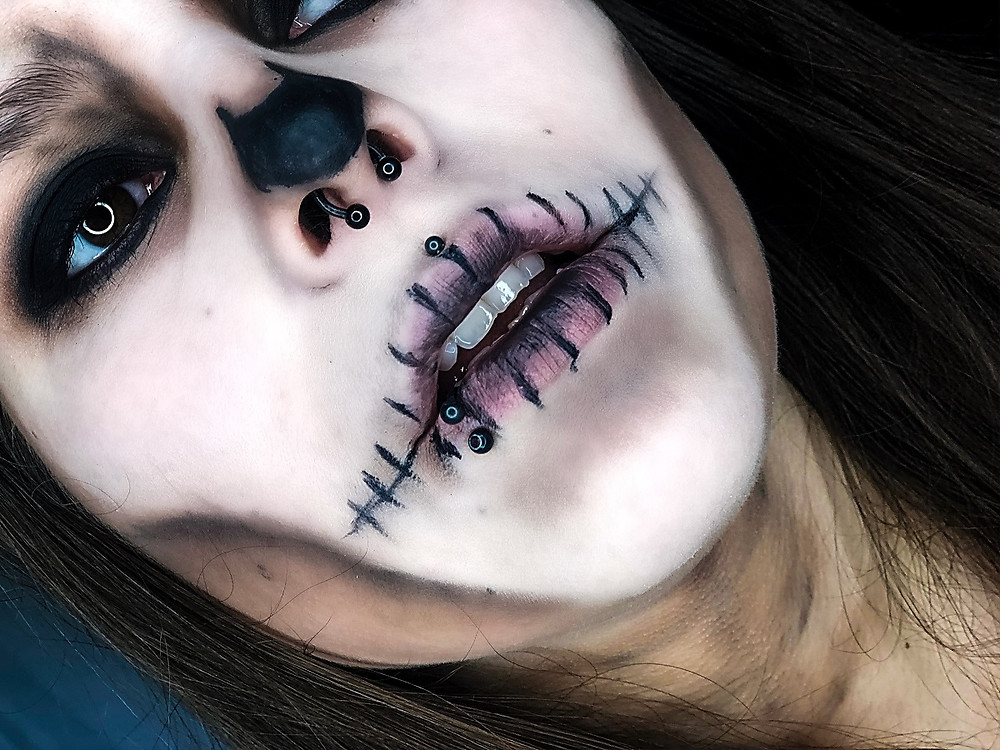 Girl with skeleton makeup with halloween contact lenses