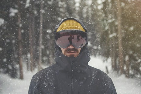 men-in-black-goggles-in-winter-in-black-jacket