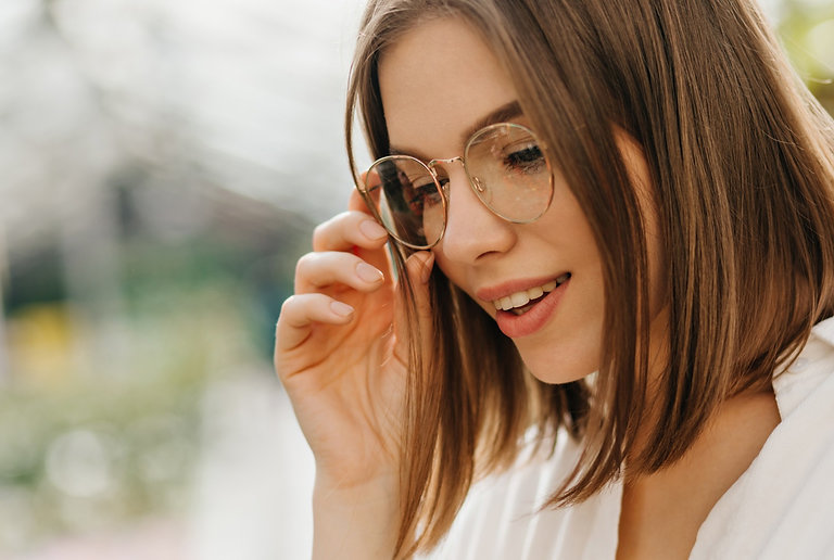 concentrated-young-woman-in-glasses-look
