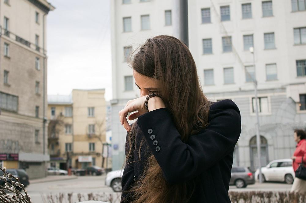 woman wearing black coat with corneal ulcer