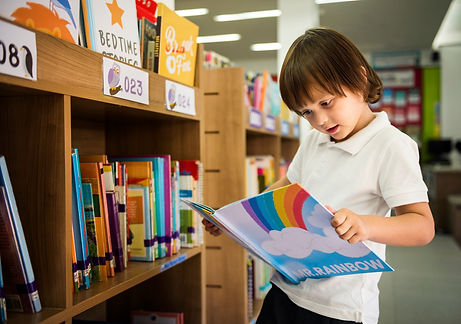 young-boy-reading-children-story-book-in