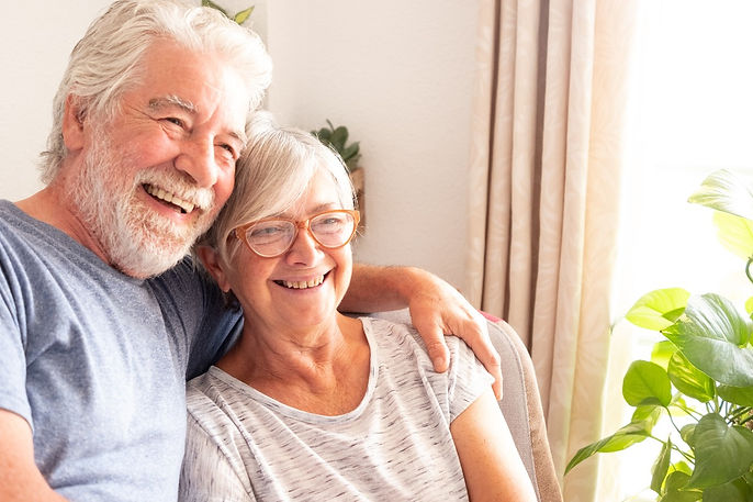 senior-adult-couple-sitting-happpy-and-r