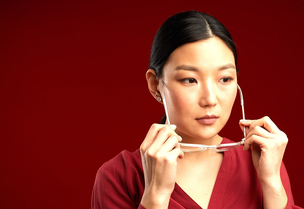 Woman putting glasses on
