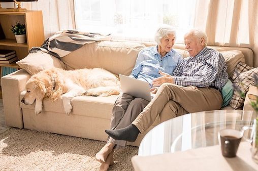 elderly couple booking hearing test online