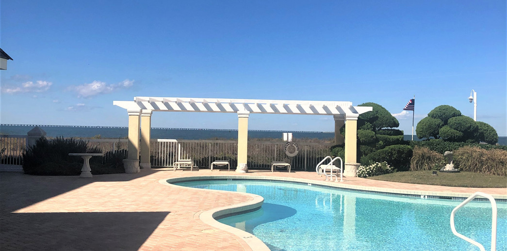 Bayfront pool with outdoor kitchen and cabana