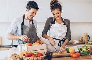 Couple wearing aprons prepping food.jpg