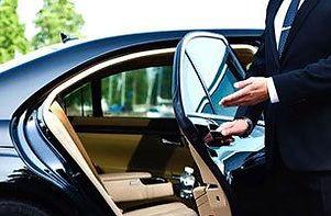 chauffeur opening door of car.jpg