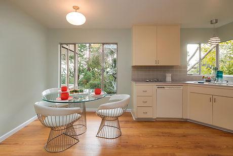Modern neutral kitchen with laminate floors.jpg