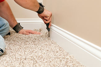 Cream carpet being fitted in neutral coloured room.jpg