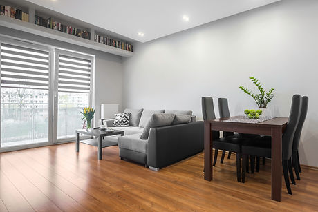Modern living and dining area with laminate flooring.jpg