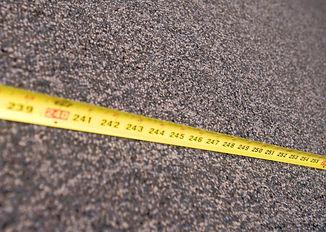 Tape measure laid out on carpet floor_edited.jpg