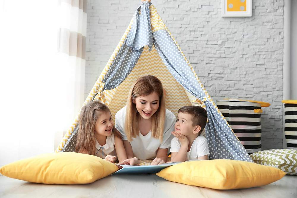 Nanny in tent with children