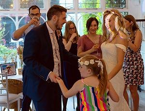 Man and child dancing at wedding_edited.jpg