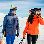 Mid-adult-couple-going-skiing-1126667711