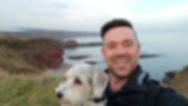 Owner and dog on cliff top walk