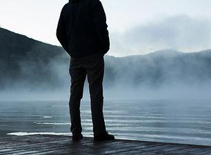 Man Looking at Fog