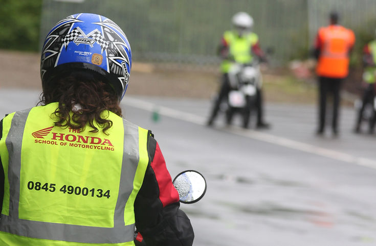 Motorcycle instructor with learner riders