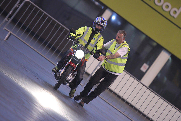 Motorcycle instructor with learner rider