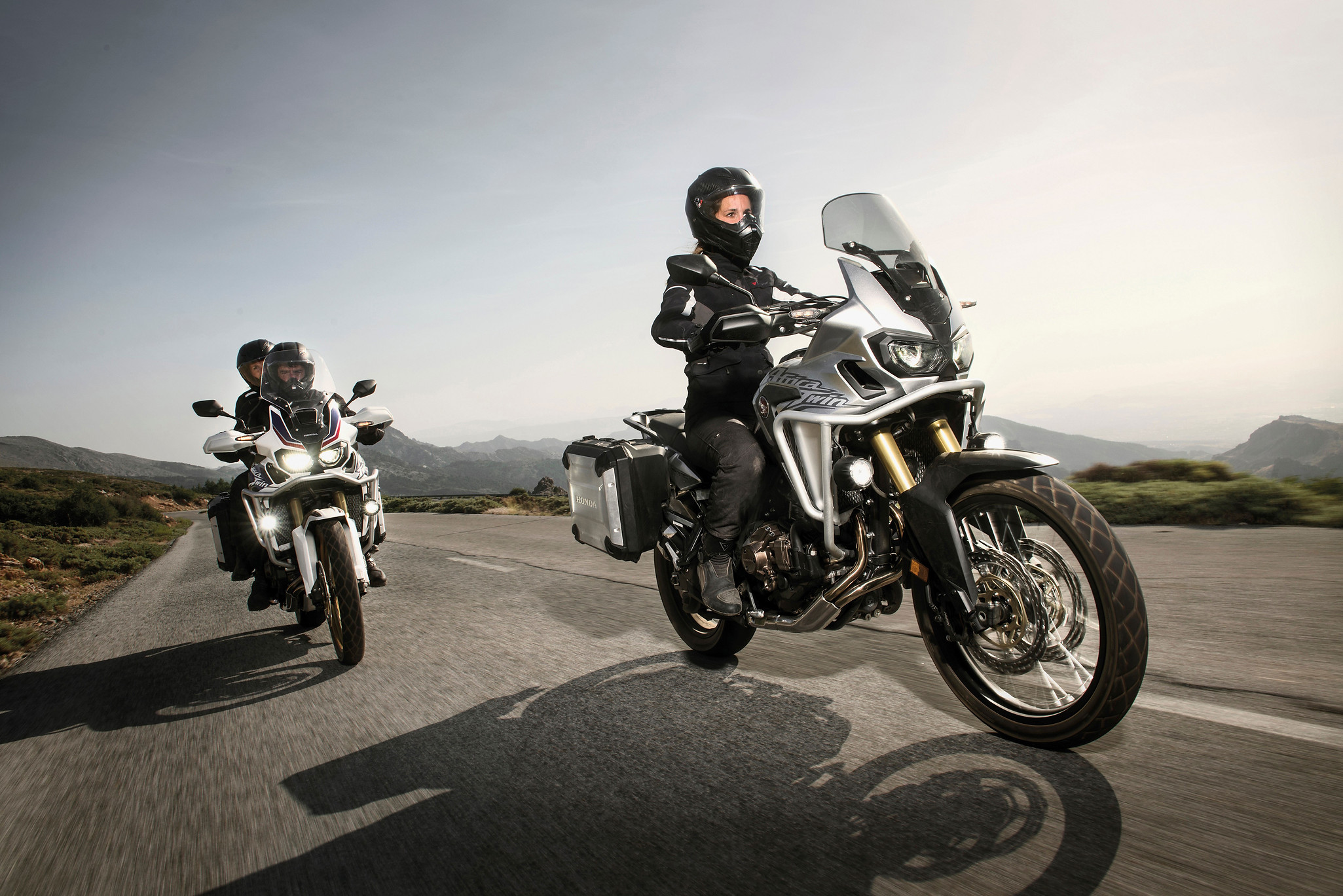 Female motorcyclist with friends