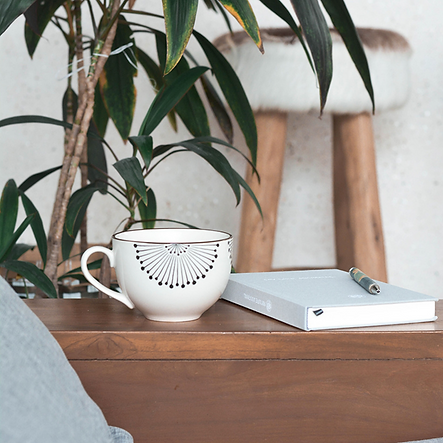 1500 desk and coffeee mug.png