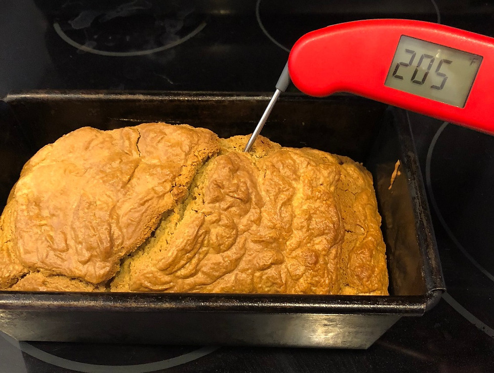 Testing doneness of bread load with thermometer