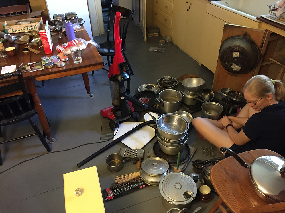 Cleaning out a cabinet of pots and pans
