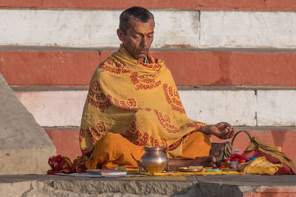 Man meditating, River Ganges, Varanasi, India