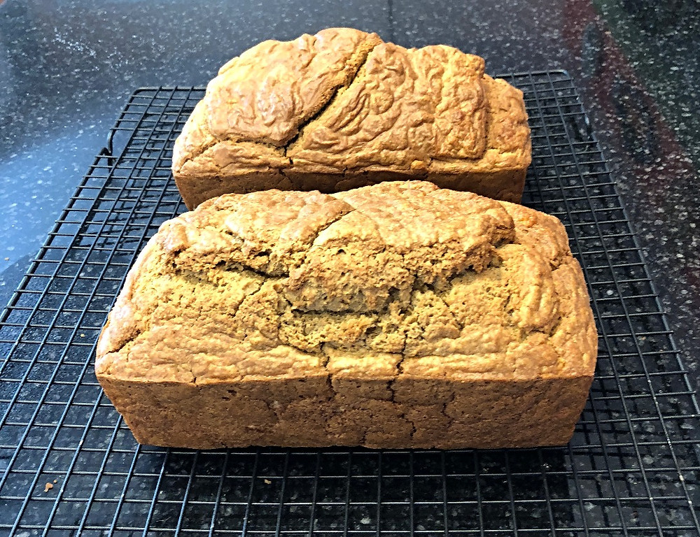 2 loaves cooling on racks