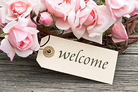 pink roses and label with lettering welc