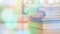 Book stack on wood desk in the library r